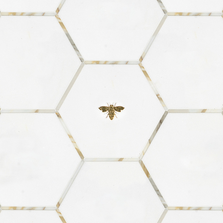 Napoleon and Bonaparte, a waterjet stone mosaic, shown in polished Calacatta, Thassos, and Gold Glass, is part of the Aurora® collection by Sara Baldwin for New Ravenna..