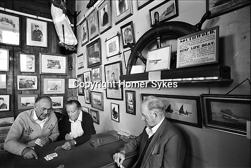 Sailors Reading Room Southwold Suffolk UK 1984. Local men playing cards.
