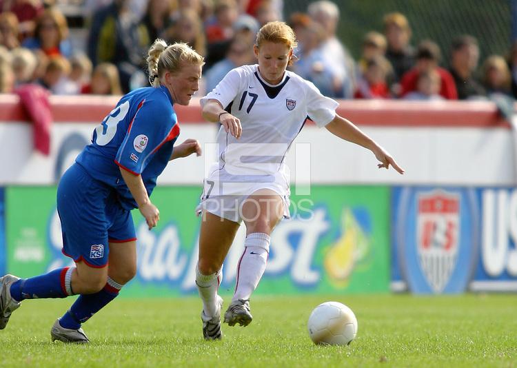 Iceland's Greta Samuelsdottir, left, races USA's Lori Chalupny, right, for the ball. The USA defeated Iceland 2-1 at Univ. of Richmond Stadium in Richmond, Virginia on Sunday, October 8, 2006.
