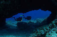 A couple (MR) pictured at a cavern enterance.  Hawaii.