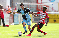 Joel Grant of Exeter City puts pressure on Luke O'Nien of Wycombe Wanderers during the Sky Bet League 2 match between Exeter City and Wycombe Wanderers at St James' Park, Exeter, England on 26 September 2015. Photo by Pinnacle Photo Agency.