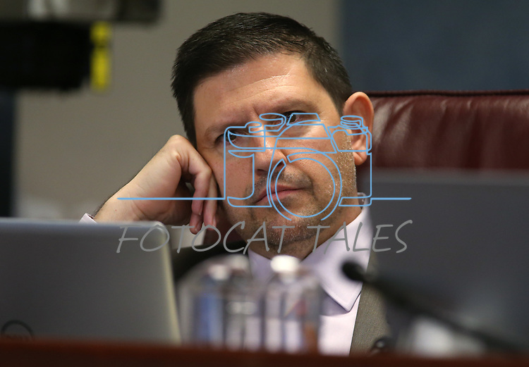 Nevada Sen. Mark Manendo, D-Las Vegas, works in committee at the Legislative Building in Carson City, Nev., on Tuesday, Feb. 10, 2015. <br /> Photo by Cathleen Allison