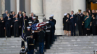 Dignitaries including former Cabinet members and members of the Bush family including former First Lady Laura Bush and President George W. Bush and watch as a military casket team carries casket of former President George. H. W. Bush to the Capitol Rotunda in Washington, DC where he will lie state, December 3, 2018. <br /> CAP/MPI/RS<br /> &copy;RS/MPI/Capital Pictures