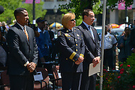 May 10, 2013  (Washington, DC)  U.S. Attorney Ronald Machen, Jr. (l), MPD Police Chief Cathy Lanier (c) and D.C. Mayor Vincent Gray stand during a ceremony at the Washington Area Law Enforcement Memorial.  (Photo by Don Baxter/Media Images International)