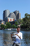 Stanislaus Wawrinka shows off the 2014 Australian Open Men's Championship trophy, which he clinched in Melbourne, Australia on January 26, 2014 by defeating Rafael Nadal.