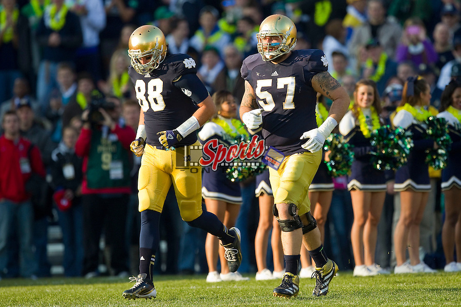 Jake Golic (88) and Mike Golic Jr. (57) of the Notre Dame Fighting Irish takes the field on Senior Day prior to the game against the Wake Forest Demon Deacons at Notre Dame Stadium on November 17, 2012 in South Bend, Indiana.  The Fighting Irish defeated the Demon Deacons 38-0.  (Brian Westerholt/Sports On Film)
