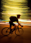 A cyclist moves through downtown montreal