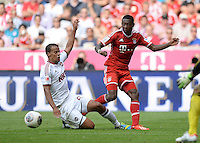 Fussball  1. Bundesliga  Saison 2013/2014  3. Spieltag FC Bayern Muenchen - 1. FC Nuernberg       24.08.2013 David Alaba (re, FC Bayern Muenchen) gegen Timothy Chandler (1 FC Nuernberg)