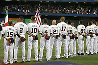 March 7, 2009:  Dustin Pedroia, Derek Jeter, Chipper Jones, David Wright, Kevin Youkilis, Adam Dunn, Ryan Braun, Shane Victorino, Heath Bell, Scott Shields, and Jonathan Broxton of Team USA stand during the national anthem during the first round of the World Baseball Classic at the Rogers Centre in Toronto, Ontario, Canada.  Team USA defeated Canada 6-5 in both teams opening game of the tournament.  Photo by:  Mike Janes/Four Seam Images