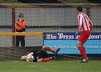 Martin McCauley saves in the Huntly v Wigtown & Bladnoch William Hill Scottish Cup 1st Round match, at Christie Park, Huntly on 25.8.12.