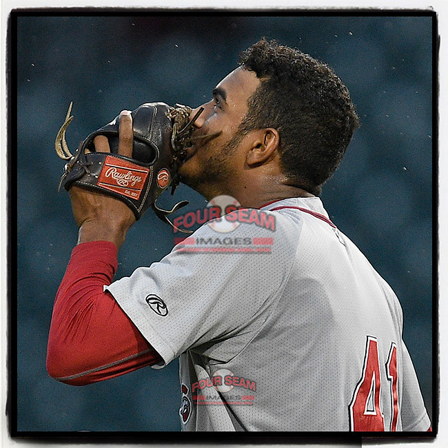 Pitcher Denyi Reyes (41) of the Greenville Drive kisses his glove after shutting out the Columbia Fireflies, 3-0, on Sunday, May 27, 2018, at Spirit Communications Park in Columbia, South Carolina. It was the Drive's first nine-inning complete game in franchise history and the first in the South Atlantic League this season. (Tom Priddy/Four Seam Images)