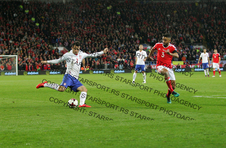 (copyright &amp; photo: STARSPORT)<br /> 12.11.16 World Cup Qualifier -  European Group D - Wales v Serbia -<br /> Antonio Rukavina of Serbia crosses under pressure from Neil Taylor of Wales