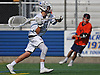 Sam Lucchesi #21, Garden City goalie, left, passes upfield during the Nassau County varsity boys lacrosse Class B final against Manhasset at Hofstra University on Tuesday, May 31, 2016. He held Manhasset scoreless in the fourth quarter to allow the Trojans to rally from a 5-1 deficit to a 7-5 win.
