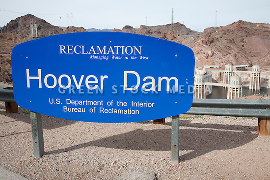 Hoover Dam, U.S. Department of the Interior, Burea of Reclamation sign with the dam in the background. Hoover Dam spans the Colorado River at the border between Nevada and Arizona. Lake Mead is the reservoir behind the dam. The dam's hydroelectric power station generates, on average, about 4 billion kilowatt-hours of power a year and is distributed to Nevada, Arizona, and California. It meets the energy needs of approximately 1.3 million people. Lake Mead is also a significant source of municipal drinking water and agricultural water for the region. Almost a decade of drought and increased water demand have brought Lake Mead near its lowest level in over 40 years. Photo taken February 2009.