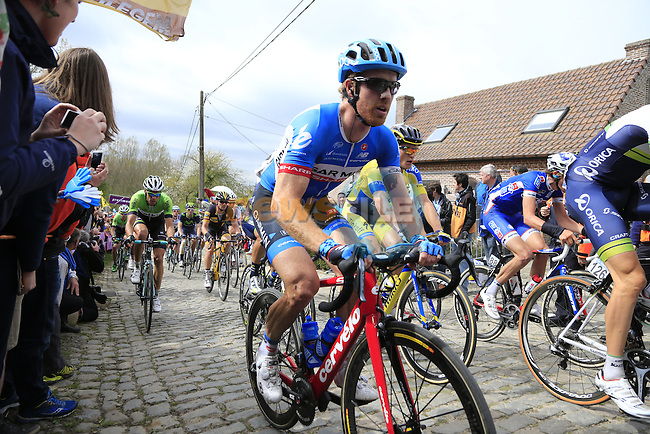 The peleton, including Tylar Farrar (USA) Garmin Sharp, climb the Molenberg during the 2014 Tour of Flanders, Belgium.<br /> Picture: Eoin Clarke www.newsfile.ie