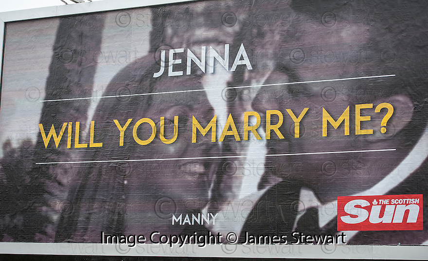 "The giant billboard poster that was put up in High Street, Kirkcaldy by Paul ""Manny"" Davies  as a surprise proposal to his girlfriend Jenna Stewart."