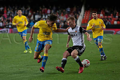 9th January 2018, Mestalla Stadium, Valencia, Spain; Copa del Rey football, round of 16, second leg, Valencia versus Las Palmas; Toni Lato of Valencia CF drives the ball against David Simon, defender for Las Palmas