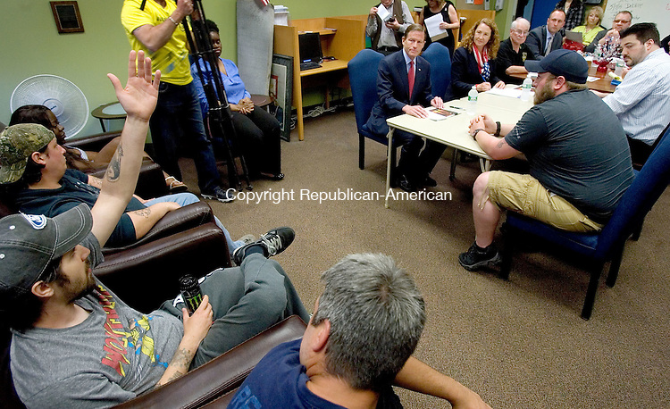 WATERBURY CT. 08 May 2015-050815SV05-Rep. Elizabeth H. Esty, D-5th District and Sen. Richard Blumenthal, D-Conn listen to veterans during a roundtable discussion on toxic burn pits in the Veterans Oasis room of the Student Center at Naugatuck Valley Community College in Waterbury Friday. <br /> Steven Valenti Republican-American