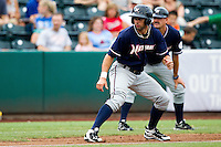 Nick Francis (3) of the Northwest Arkansas Naturals takes a lead off of third base during a game against the Springfield Cardinals at Hammons Field on July 31, 2011 in Springfield, Missouri. Northwest Arkansas defeated Springfield 9-1. (David Welker / Four Seam Images)