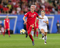 GRENOBLE, FRANCE - JUNE 15: Sophie Schmidt #13 of the Canadian National Team passes back to goalkeeper during a game between New Zealand and Canada at Stade des Alpes on June 15, 2019 in Grenoble, France.