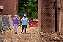 CPDC staff consult with construction crew at Howard Manor in Arlington, Virginia on July 11, 2013.<br /> <br /> (Photo by http://momentacreative.com)