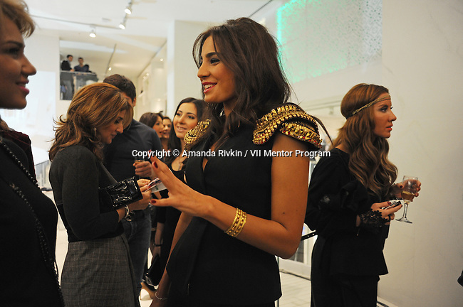 Young women talk at the grand opening celebration of Emporium's second store at the Port Baku luxury residences in the Azeri capital of Baku, Azerbaijan on October 28, 2011. Emporium's second store in Baku was designed by Japanese architect Yukio Ishiyama of the Milanese design firm Garde and features over 150 luxury ready-to-wear brands such as Azzedine Alaïa, Marc Jacobs and Stella McCartney; Emporium is widely considered to offer the greatest variety of high-end designer shopping in Baku under one roof.