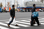 Workers carry merchandise at the new Tokyo Metropolitan Central Wholesale Market which opened in Toyosu on October 11, 2018, Tokyo, Japan. The new fish market replaces the famous Tsukiji Fish Market which closed for the last time on Saturday 6th October. The move to Toyosu was delayed for almost 2 years because of fears over toxins found in water below the new market. (Photo by Rodrigo Reyes Marin/AFLO)
