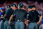 6 October 2017: Six MLB umpires discuss a base path call during the first game of the NLDS between the Washington Nationals and the Chicago Cubs at Nationals Park in Washington, DC. The Cubs shut out the Nationals 3-0 to take a 1-0 lead in their best of five Postseason series. Mandatory Credit: Ed Wolfstein Photo *** RAW (NEF) Image File Available ***