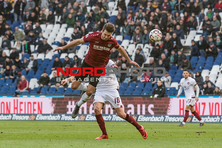 09.02.2019, HDI Arena, Hannover, GER, 1.FBL, Hannover 96 vs 1. FC Nuernberg<br /> <br /> DFL REGULATIONS PROHIBIT ANY USE OF PHOTOGRAPHS AS IMAGE SEQUENCES AND/OR QUASI-VIDEO.<br /> <br /> im Bild / picture shows<br /> Hendrik Weydandt (Hannover 96 #26) im Duell / im Zweikampf mit Hanno Behrens (Nuernberg #18), <br /> <br /> Foto © nordphoto / Ewert