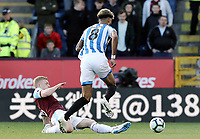 Huddersfield Town's Philip Billing is fouled by Burnley's Ben Mee who received a yellow card for the challenge<br /> <br /> Photographer Rich Linley/CameraSport<br /> <br /> The Premier League - Burnley v Huddersfield Town - Saturday 6th October 2018 - Turf Moor - Burnley<br /> <br /> World Copyright &copy; 2018 CameraSport. All rights reserved. 43 Linden Ave. Countesthorpe. Leicester. England. LE8 5PG - Tel: +44 (0) 116 277 4147 - admin@camerasport.com - www.camerasport.com