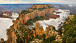 Summer Monsoon clouds swirl around Wotan's Throne, a prominent temple viewed from Grand Canyons North Rim viewpoint, Cape Royal