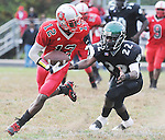 The Gazette Suitland High School's #12 Lavern Jacobs gains yards after the catch as C.H. Flowers' #22 John Clark pursues during Suitland's 21-20 overtime win over C.H. Flowers at Flowers on Saturday afternoon.