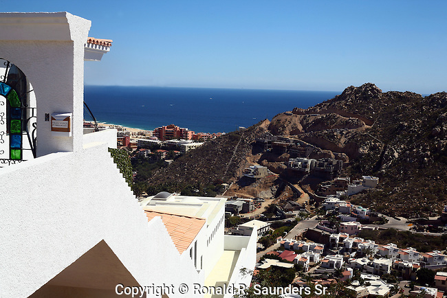 PEDREGAL, a wealthy hillside community, overlooks the Pacific Ocean and a vista of Cabo San Lucas