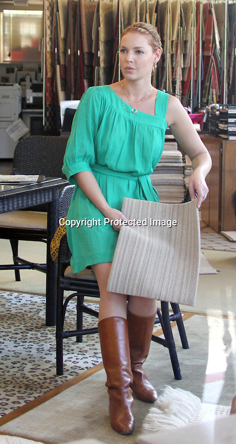 8-22-09  ..Katherine Heigl shopping for carpet with her husband Josh Kelley in Hollywood California.  Mrs Heigl was sitting on her husbands lap in a lovely green dress.  Katherine seemed very picky about the texture of her carpet, we noticed her intensly rubbing a huge circle of samples inside the store. As the couple left Katherine stopped to sign an autograph for a child ...AbilityFilms@yahoo.com.805-427-3519.www.AbilityFilms.com