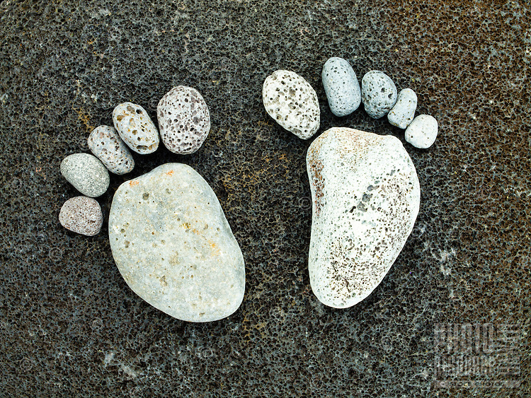 Feet made of the stones of Pololu Valley on the Big Island of Hawai'i.