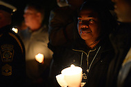 May 13, 2013  (Washington, DC) Attendees of the 25th Annual Candlelight Vigil hold candles in tribute to fallen officers at the National Law Enforcement Officers Memorial in the District of Columbia. The event is part of National Police Week. (Photo by Don Baxter/Media Images International)
