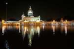 "Gurudwara Bangla Sahib is the most prominent Sikh gurdwara, or Sikh house of worship, in Delhi, known for its association with the eighth Sikh Guru, Guru Har Krishan, and the pond inside its complex, known as the ""Sarovar"", whose water is considered holy by Sikhs and is known as ""Amrit"". It was built by Sikh General, Sardar Bhagel Singh in 1783, who supervised the construction of nine Sikh shrines in Delhi in the same year, during the reign of Mughal Emperor, Shah Alam"