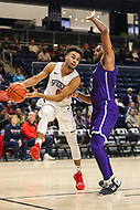 Washington, DC - December 22, 2018: Richmond Spiders guard Jacob Gilyard (0) passes the ball during the DC Hoops Fest between Hampton and Howard at  Entertainment and Sports Arena in Washington, DC.   (Photo by Elliott Brown/Media Images International)