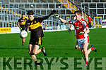 Jordan Kiely, Dr Crokes and Conor Jenkins, Rathmore in action in the East Kerry Semi final in Fitzgerald stadium, Killarney last Sunday afternoon.
