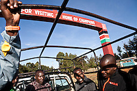 A group of Kenyan runners coached by Renato Canova ride out for training in the back of a pickup trucK in Iten, kenya.