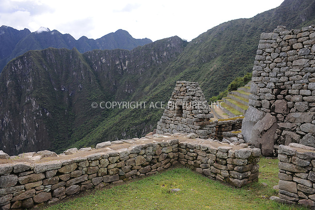 """WWW.ACEPIXS.COM . . . . . .January 8, 2013...Peru....Machu Picchu is a pre-Columbian 15th-century Inca site located 2,430 metres (7,970 ft) above sea level. It is situated on a mountain ridge above the Urubamba Valley in Peru, which is 80 kilometres northwest of Cusco and through which the Urubamba River flows. Most archaeologists believe that Machu Picchu was built as an estate for the Inca emperor Pachacuti (1438-1472). Often referred to as the """"City of the Incas""""  on January 8, 2013 in Peru ....Please byline: KRISTIN CALLAHAN - ACEPIXS.COM.. . . . . . ..Ace Pictures, Inc: ..tel: (212) 243 8787 or 212 489 0521..e-mail: kristincallahan@aol.com...web: http://www.acepixs.com ."""
