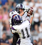 HARTFORD, SD - AUGUST 30: Brady Dam #3 from Dakota Valley intercepts a pass over teammate Trevor McCabe #11 against West Central during the second quarter of their game Friday night at West Central. (Photo by Dave Eggen/Inertia)