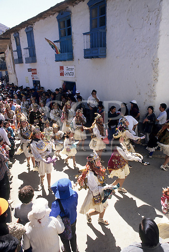 Paucartambo, Peru. Festival of Virgin of Carmen; people on the streets with colourful Conquistador masks.