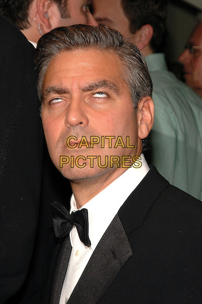 """GEORGE CLOONEY.Premiere of her new film """"Good Night, And Good Luck"""" at Avery Fisher Hall at Lincoln Center, part of the 43rd New York Film Festival, New York, New York.   .Photo Credit: Patti Ouderkirk AdMedia/Capital Pictures.Ref: PO.September 23rd, 2005.headshot portrait eyes funny.www.capitalpictures.com.sales@capitalpictures.com.© Capital Pictures."""
