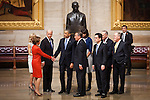 Congressional minority leader Nancy Pelosi shakes  President Barack Obama's hand in front of a statue of Martin Luther King Jr. in the US Capitol Rotunda after the inaugural luncheon, January 21, 2013 in Washington, D.C.