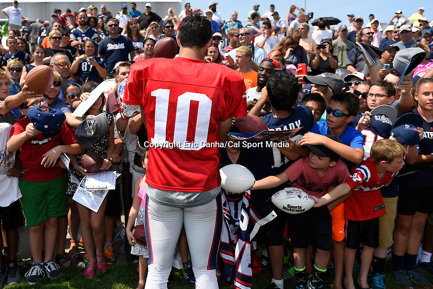 August 1, 2015, Foxborough, MA - Fans swarm New England Patriots quarterback Jimmy Garoppolo (10) for a chance at getting an autograph during the New England Patriots training camp held on the practice field at Gillette Stadium. Eric Canha/CSM