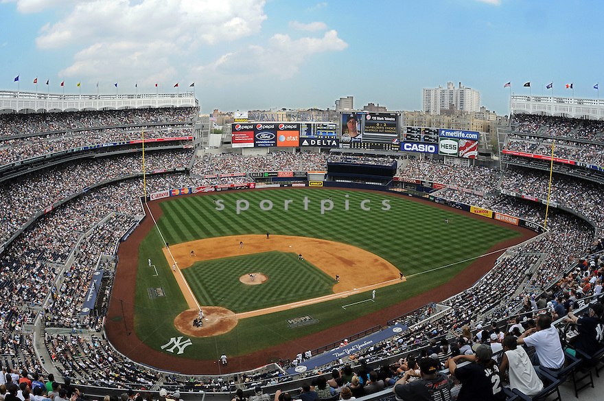 An overall view of Yankee Stadium in New York, during a game between the New York Yankees and the Oakland Athletics on July 25, 2009. (AP Photo/Chris Bernacchi)