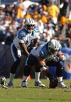 Sept. 17, 2006; San Diego, CA, USA; Tennessee Titans quarterback (10) Vince Young prepares to take the snap from center (68) Kevin Mawae against the San Diego Chargers at Qualcomm Stadium in San Diego, CA. Mandatory Credit: Mark J. Rebilas