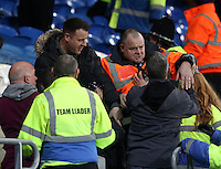 An Aston Villa fan clashes with a steward as tempers flare between the Cardiff and Aston Villa fans after the final whistle of the Sky Bet Championship match between Cardiff City and Aston Villa at The Cardiff City Stadium, Cardiff, Wales, UK. Monday 02 January 2017