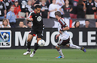 D.C. United forward Dwayne de Rosario (7) goes against Colorado Rapids defender Drew Moor (3) D.C. United defeated the Colorado Rapids 2-0 at RFK Stadium, Wednesday May 16, 2012.